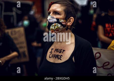 Barcelona, Spain. 7th June, 2020. A protestor has a slogans painted on her chest during a protest against racism and police brutality during a tribute to Afro-American citizen George Floyd who was killed while being restrained by Minneapolis police. Credit: Matthias Oesterle/Alamy Live News - Stock Photo