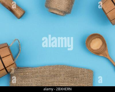 Everyday objects from wood and other natural materials on a blue background. - Stock Photo