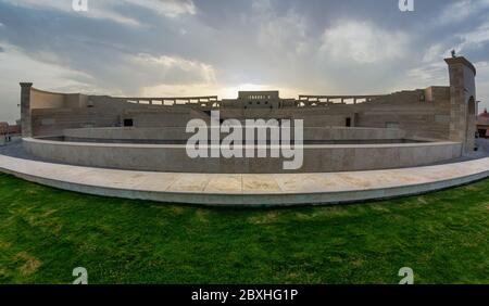 The amphitheater in Katara Cultural Village, Doha Qatar panoramic view in daylight with clouds in the sky in background. - Stock Photo