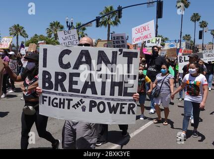 Oceanside, CA / USA - June 7, 2020: Protesters hold up a signs during a peaceful Black Lives Matter protest march in San Diego County. - Stock Photo