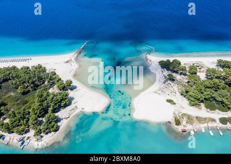 Aerial drone view of Port Glarokavos and lagoon beach in Kassandra penisula Chalkidiki Greece