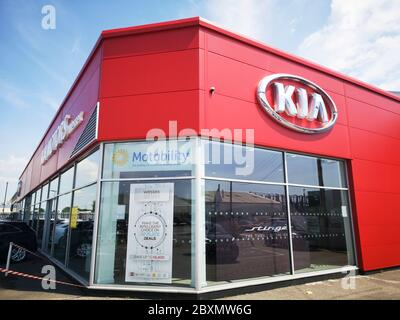 Cardiff, UK: June 02, 2020: Kia Car Dealership with new and used cars for sale. Kia Motors Corporation, commonly known as Kia Motors. - Stock Photo