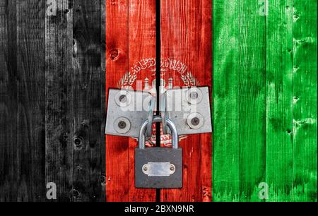 Afghanisatan flag on door with padlock - Stock Photo
