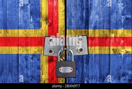Aland flag on door with padlock - Stock Photo