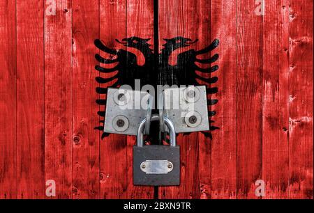 Albania flag on door with padlock - Stock Photo