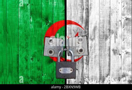 Algeria flag on door with padlock - Stock Photo