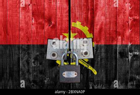 Angola flag on door with padlock - Stock Photo