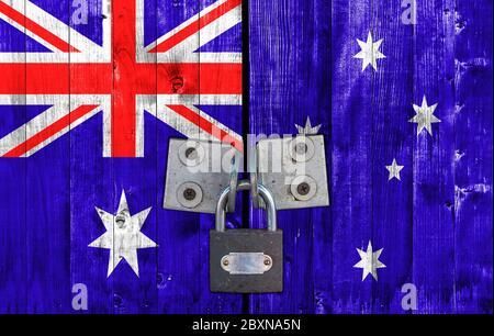 Australia flag on door with padlock - Stock Photo