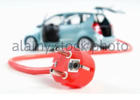 Modernes Auto mit Kabel und Stecker - Stock Photo