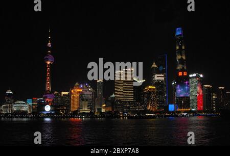 Shanghai, China at night.  The tall modern buildings in the business district of Lujiazui in Pudong, Shanghai. Wide view of the Shanghai skyline. - Stock Photo