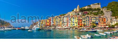 Panorama of colorful picturesque harbour of Porto Venere with San Lorenzo church, Doria Castle and Gothic Church of St. Peter, Italian Riviera, Liguri - Stock Photo