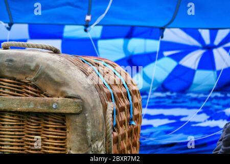 Inflating blue hot air ballon - Stock Photo