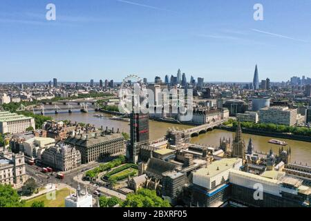 An aerial view of London showing the London Eye (centre) County Hall, Westminster Bridge leading to the Park Plaza Westminster Bridge hotel, Hungerford Bridge and the Royal Festival Hall, Waterloo Bridge, and the Queen Elizabeth Tower, which is covered in scaffolding during refurbishment, and part of the Palace of Westminster. - Stock Photo
