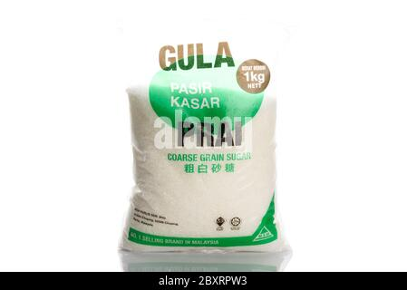 Kuching, Sarawak / Malaysia - May 10, 2020: halal coarse grain sugar of prai brand in a packet of white background