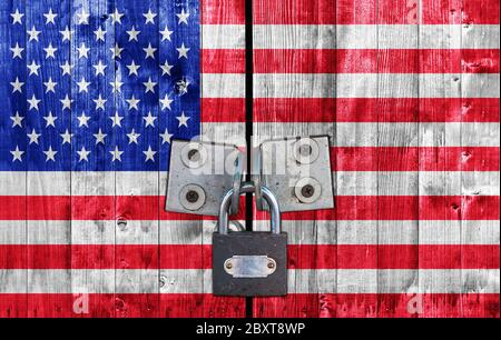 United States flag on door with padlock - Stock Photo