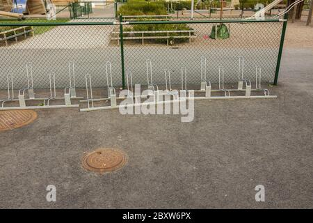 Great view of an empty bicycle parking spot near house. Sweden. - Stock Photo
