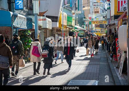 People walking in Ameyoko market, Tokyo, Japan - Stock Photo