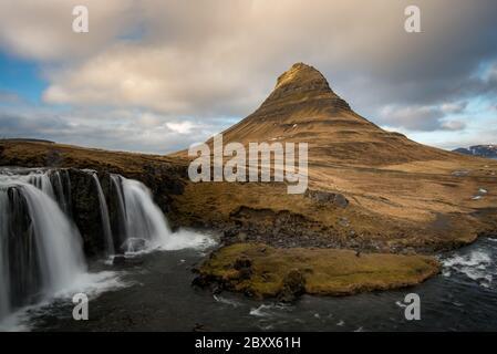 The Kirkjufell mountain and the kirkjufellfoss waterfall at grundarfjordur at Snaefellsnes peninsula in Iceland - Stock Photo