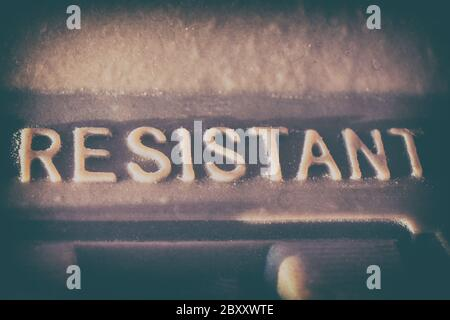 The word 'RESISTANT' written in vintage press stamp - Stock Photo