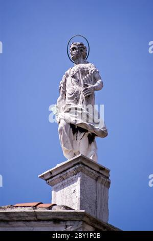 Statue of Saint Jerome on the roof of the church of San Sebastiano constructed in the mid 16th century in Venice, Italy. - Stock Photo