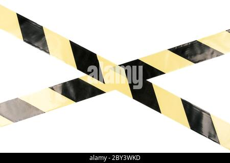 Yellow-black restrictive tape on a light background - Stock Photo