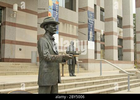 Statues of Frederick Augustus Olds (nearest) and Thomas Day, outside North Carolina Museum of History, Bicentennial Plaza, Raleigh, NC, USA - Stock Photo