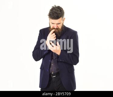 Bad news. Adult sad man reads the message on a smartphone.