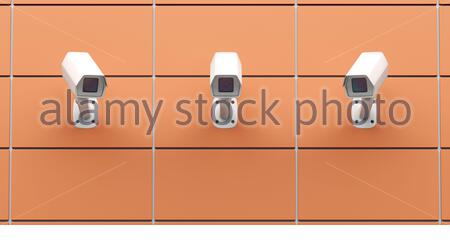 Three CCTV cameras mounted on the wall, front view - Stock Photo