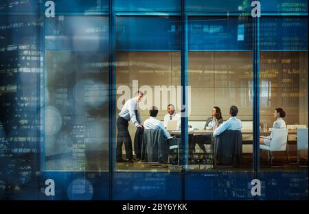 Corporate business people meeting in highrise conference room - Stock Photo