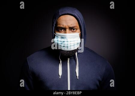 Portrait of dissatisfied afro american guy fee upset african people discrimination looting wear fashion sweater medical mask isolated over black