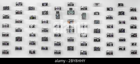 Collection of old film cameras on a white background. Panorama.
