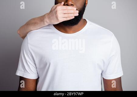 Do not speak. Cropped photo of african american guy unfairly society shut up black race citizens need help white skin arm close his mouth danger