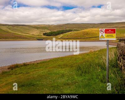 Castleshaw Upper Reservoir. No Swimming, Danger Deep Water sign. Lancashire UK. - Stock Photo