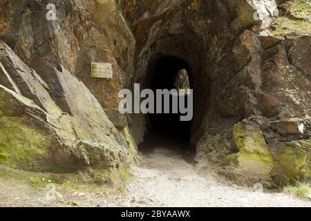 Old miners tunnel in the Buttermere Valley, Cumbria, UK - Stock Photo
