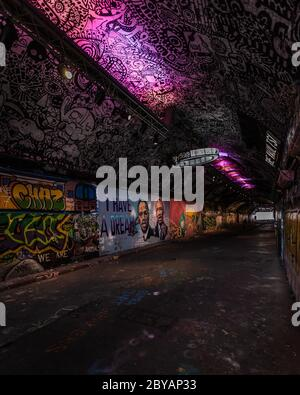 Black Lives Matter represented in London's famous Leake Street graffiti tunnel. Portraits of Martin Luther King, and Malcolm X on the wall. - Stock Photo