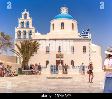 Blue domed Church, Panagia Platsani in the town of Oia on the Greek island of Santorini on the Aegean sea. - Stock Photo