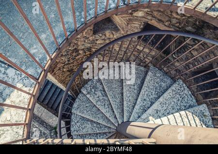 Desenzano del Garda, Italy, September 11, 2019: Spiral staircase with stairs of old medieval castle Castello, Lombardy, Northern Italy - Stock Photo