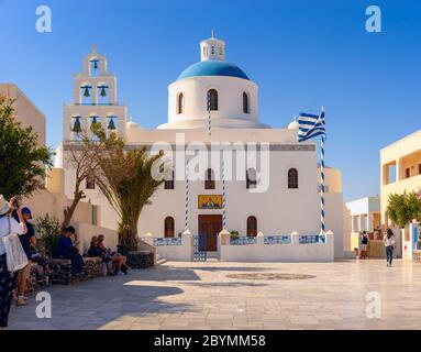 Blue domed Church, Panagia Platsani in the town of Oia on the Greek island of Santorini - Stock Photo