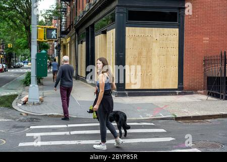 High-end boutiques along trendy Bleecker Street in the Greenwich Village neighborhood in New York are boarded up in anticipation of a repeat of looting and vandalization associated with the protests related to the death of George Floyd, seen on Wednesday, June 3, 2020. (© Richard B. Levine) - Stock Photo