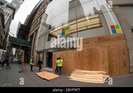 The looted Microsoft store on Fifth Avenue in New York is boarded up after the previous nights looting and in anticipation of a repeat of looting and vandalization associated with the protests related to the death of George Floyd, seen on Tuesday, June 2, 2020. (© Richard B. Levine) - Stock Photo