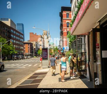 "Customers take advantage of relaxed liquor laws and ""grab and go"" cocktails at a restaurant in Chelsea in New York on Saturday, May 30, 2020. (© Richard B. Levine) - Stock Photo"
