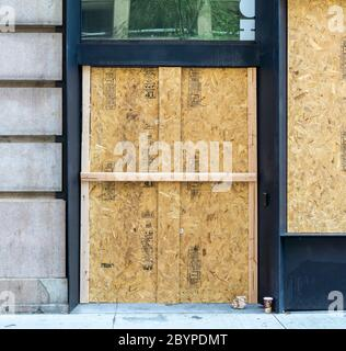 Boutiques and stores in New York are boarded up because of looting and vandalization associated with the protests related to the death of George Floyd, seen on Saturday, June 6, 2020. (© Richard B. Levine) - Stock Photo