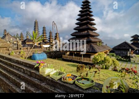 Rendang, Bali Island, Indonesia. 15th May, 2019. Offerings at Pura Besakih is a complex of 22 temples on the slopes of Mount Gunung Agung volcano. - Stock Photo