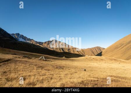 dramatic mountain hiking landscape in Juta trekking area landscape in autumn -  popular trekking  in the Caucasus mountains, Kazbegi region, Georgia.