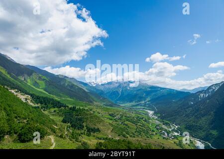 Svaneti mountain and village landscape at the trekking and hiking route near Mestia village in Svaneti region, UNESCO heritage area in Georgia.