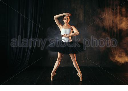 Elegance ballerina in action on theatrical stage. Classical ballet dancer in motion - Stock Photo