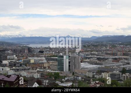 Zurich, in the background Lake Zurich and the mountains, view from Hönggerberg - Stock Photo