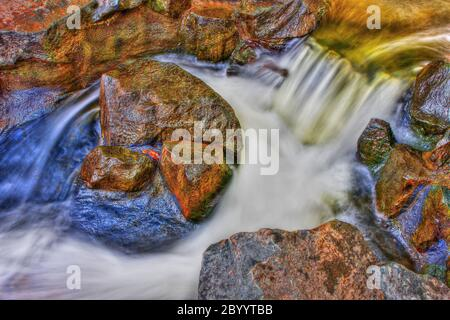 Creek Rock, Rapids and water fall in HDR High Dynamic Range - Stock Photo
