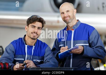 industrial manufacturing workers in factory - Stock Photo