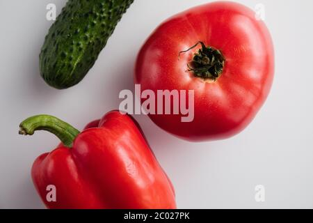 Pepper tomato cucumber on a white background. Minimum concept. Top view - Stock Photo